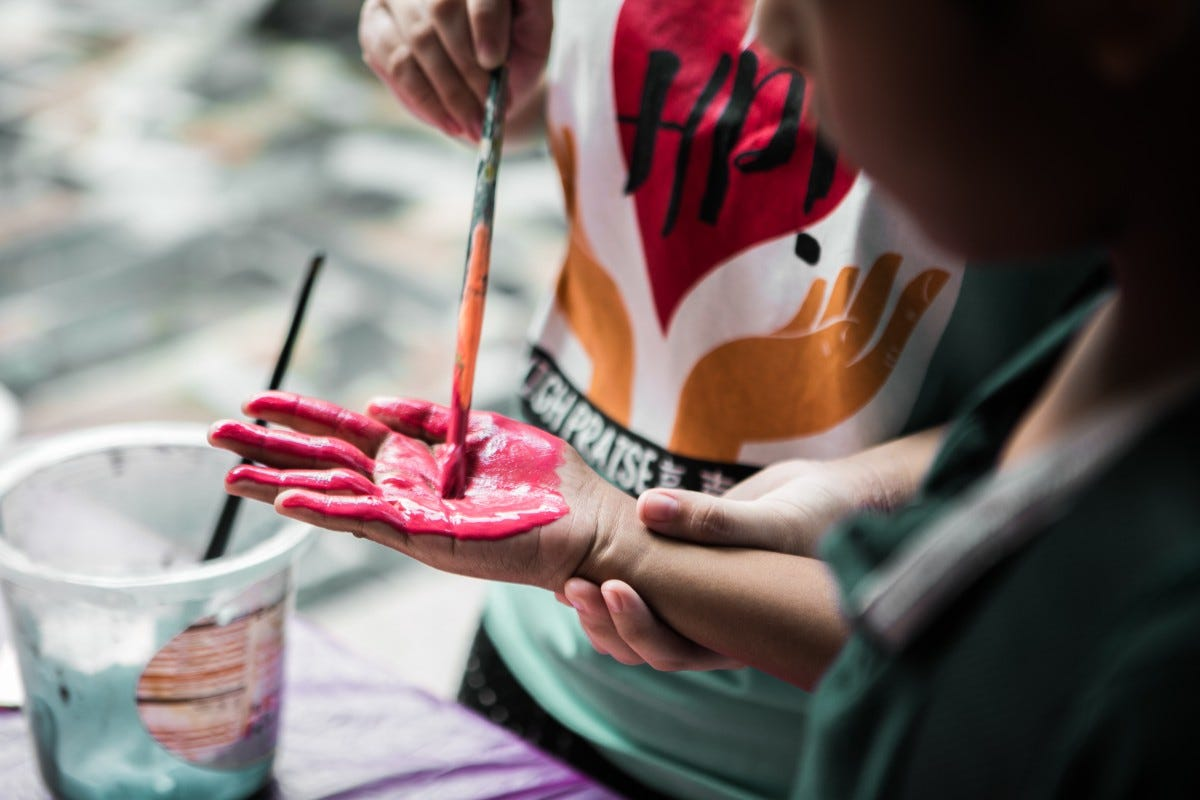 kids crafting red paint handprint